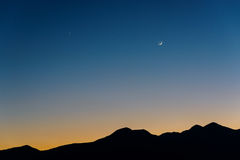 The Moon, Venus and Saturn after sunset Stock Photos