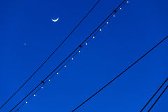 The Moon and Venus, silhouetted with the masts of the USS Conste Royalty Free Stock Images