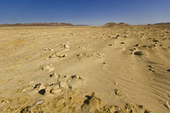 Moon view of desert with sand and stones on surface Royalty Free Stock Photo