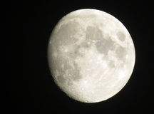 Moon waxing to full. Nearly full moon captured with zoom lens Royalty Free Stock Photo