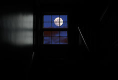 Moon in the window. Full moon seen through the window from completely dark room Stock Photos