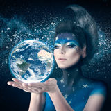 Moon woman holding planet earth Stock Image