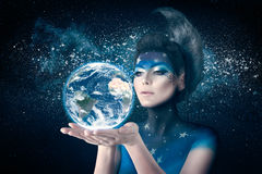 Moon woman holding planet earth Royalty Free Stock Photography