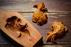 Mooncake cookies. Together with wooden mould on wooden background stock images