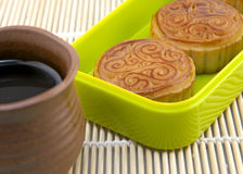 Mooncake served with tea Stock Images