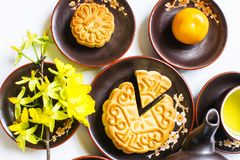 Mooncake and tea, food and drink for Chinese mid autumn festival. Isolated on white background. Mooncake and tea, food and drink for Chinese mid autumn festival stock photos
