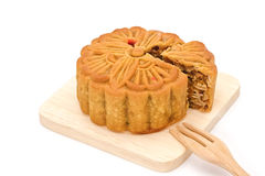 Mooncake on wooden plate for the chinese Mid Autumn festival. On white background Stock Photography