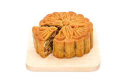 Mooncake on wooden plate for the chinese Mid Autumn festival. On white background Stock Photos