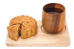 Mooncake on wooden plate for the chinese Mid Autumn festival. On white background Royalty Free Stock Image