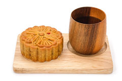 Mooncake on wooden plate for the chinese Mid Autumn festival. On white background Royalty Free Stock Images
