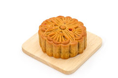 Mooncake on wooden plate for the chinese Mid Autumn festival. On white background Stock Images