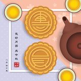 Mooncakes de 'Tuan Yuan 'con la tetera y el té ilustración del vector