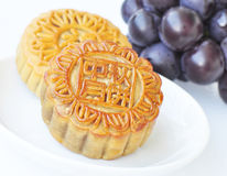 Mooncakes and grapes Royalty Free Stock Photo