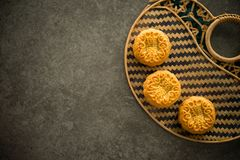 Free Mooncakes On Bamboo Background Low Light With Copyspace Royalty Free Stock Image - 124238246
