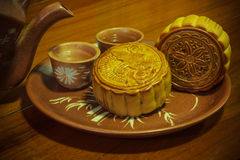 Mooncakes and the tea. Is ready to eat Stock Images