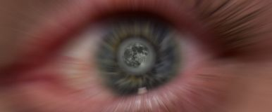 Eye Ball. A sharp moon in a blurry eyes pupil Royalty Free Stock Image