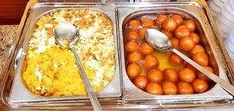 Moong daal Halwa, Indian party dessert and Gulab Jamun stock image