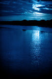 Moonlight. Bright moonlight and cloudscape over coastline water royalty free stock images
