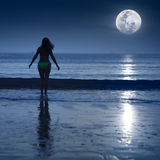 Moonlight. Woman is going to swimming under moonlight stock image