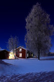 Moonlight. An old house in the cold winter night Stock Photography