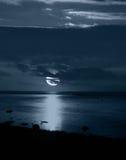 Moonlight. Reflecting on peaceful beach Royalty Free Stock Photo
