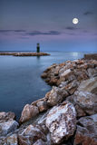 Moonlight Bay Moon Lighthouse. A seascape by the light of the Moon Royalty Free Stock Image