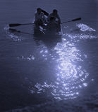 Moonlight boating Stock Photos
