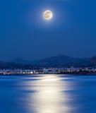 Moonlight on the city. The moonlight is reflected on the sea in the bay of the city of Palermo (Italy Royalty Free Stock Photos