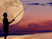Moonlight Fishing. Fishing in the light of a very large moon with beautiful colors Stock Images