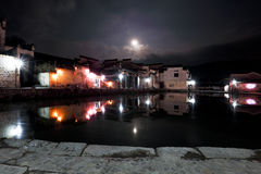 The moonlight of historic buildings around the pond, quiet as a picture Stock Image