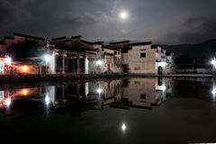 The ancient buildings beside the pond in the moonlight Royalty Free Stock Images