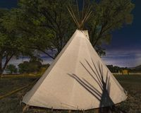 Moonlight on Indian Tepee at Ute Indian Museum, Montrose, Colorado. SEPTEMBER 26, 2018 - UTE INDIAN MUSEUM, MONTROSE, COLORADO, USA - Moonlight on Indian Tepee royalty free stock photos