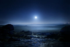 Moonlight Landscape. Glowing mist from moonlight over Dartmoor, UK stock images