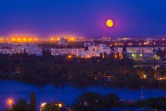 Moonlight night in the city. Full moon above Voronezh skyline royalty free stock photos