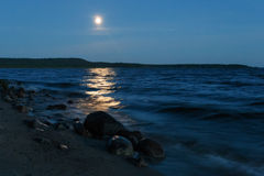 Moonlight on the night lake stock images