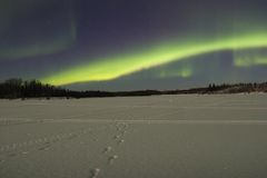 Moonlight Over Frozen Lake Under Northern Lights Royalty Free Stock Images