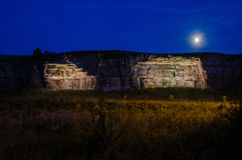 Moonlight over illuminated cliffs Royalty Free Stock Photography