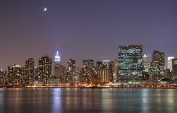 Moonlight over Manhattan. At twilight Royalty Free Stock Images