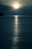 Moonlight over the sea Stock Image