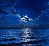 Moonlight over water Stock Photos