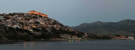 Molyvos with castle restaurants hotels and bars in the evening. Moonlight Panorama of the popular holiday resort of Molyvos with castle restaurants hotels and stock photo