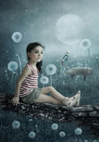 Moonlight Sonata. The little girl in the country of dandelions listens Moonlight Sonata in the performance of grasshopper stock photography