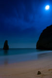Moonlit beach and rock Royalty Free Stock Images