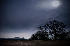 Moonlit Field. With farmhouse in distance, Worcestershire, UK stock images