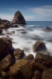 Moonlit Night on the Sea. Sea landscape with rocks near the shore waves and foam. Moonlit night and stormy sea. Crimea, Ukraine, Europe royalty free stock photo
