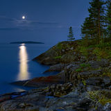 Moonlit night at stony shore of Ladoga lake Royalty Free Stock Photos