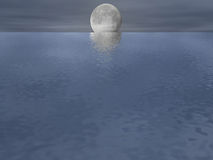 Moonlit Ocean. With a slight overcast Royalty Free Stock Photo