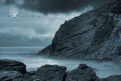 Moonlit ocean. Moon over calm ocean with a flock of flying birds Stock Images