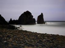 Moonlit overcast seascape. Long exposure. Praia da Ursa, Sintra, Portugal. Analog: 120 slide film stock images