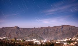 Star trails Landscape Hills. In a moonlit stars trail above a mountain and a village in Swat Pakistan Royalty Free Stock Images